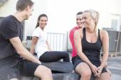 Happy workout team taking a break outdoor — Stock Photo