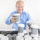Business man drinks too much coffee — Stock Photo