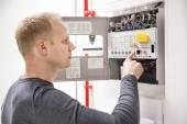 Technician checks fire panel in data center — Stock Photo