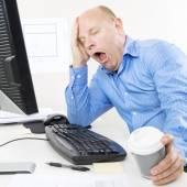 Overworked and tired businessman — Stock Photo