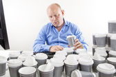 Overworked businessman drinking too much coffee — Stock Photo