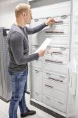 IT engineer works in large fuse cabinet — Stockfoto