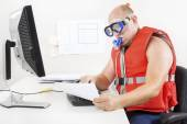 Strange businessman in diving mask and snorkel — Stock Photo