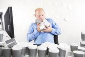 Businessman with coffee addiction — Stock Photo
