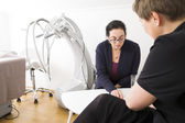 Client consultation at body shape clinic — Stock Photo