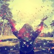 Young girl spreading hands with joy and inspiration facing the sun,sun greeting,freedom concept,bird flying above sign of freedom and liberty — Stock Photo #67603929
