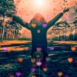 Young girl spreading hands with joy and inspiration facing the sun,sun greeting,freedom concept,bird flying above sign of freedom and liberty — Stock Photo #67605479