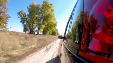 Car driving through the countryside. The camera is left outside. — Stock Video