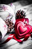 Holiday ribbon on wooden background — Stock Photo