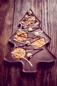 Chocolate christmas tree on wooden background — Stock Photo