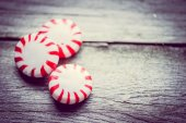 Peppermint candies on wooden background — Stock Photo
