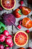 Red fruits and vegetables on wooden background — Stock Photo