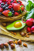 Fruits and vegetables on rustic background — Stock Photo