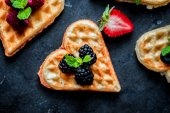Heart waffles with berries — Stock Photo