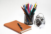 Notebook with pen box and clock — Stockfoto