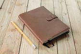 Notebook on wood background — Stock Photo