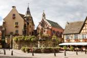 Castle, church and fountain named Saint Leon in Eguisheim village in France — Stock Photo