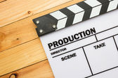 Movie slate film on wooden table — Stock Photo