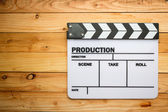 Movie slate film on wooden table — Stock fotografie