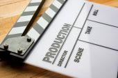 Movie slate film on wooden table — Foto de Stock