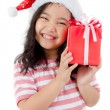 Little Asian girl in Santa hat and red gift box isolated on white — Stock Photo #60180191
