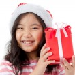 Little Asian girl in Santa hat and red gift box isolated on white — Stock Photo #60180181