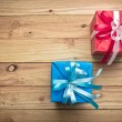 Vintage gift box on old wooden background — Stock Photo #60180607
