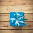 Vintage gift box on old wooden background — Stock Photo #60180629