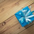 Vintage gift box on old wooden background — Stock Photo #60180679