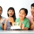 Asian family blowing birthday candles — Stock Video #65769777