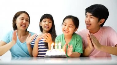 Asian family blowing birthday candles — Stock Video