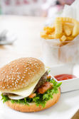 Closeup of home made burgers on table background — Stock Photo
