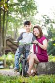 Little Asian child with mother practice to riding a bicycle — Stock Photo