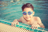 Portrait of happy little boy playing in the pool — Stock Photo