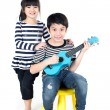 Little asian child with akulele — Stock Photo #60800893