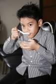 Little asian child drinking cream of thai dessert — Stock Photo