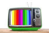 Green Vintage TV on wood table  — Stockfoto