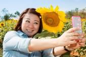 Happy asian woman selfy with sun flower in sunflower flower fiel — Stock Photo