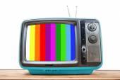 Niebieski Tv Vintage na stół z drewna — Zdjęcie stockowe