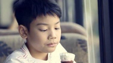 Little asian cute boy enjoy eating an ice cream — Stockvideo