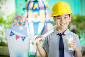Young asian child holding a glass of milk — Stock Photo