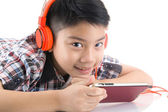 Asian boy ware headphone and playing the cell phone — Stockfoto