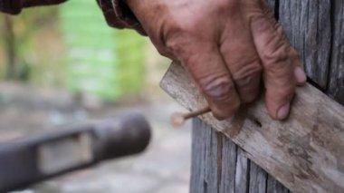 Closeup of Carpenter using equipment to repair the furniture — Stock Video