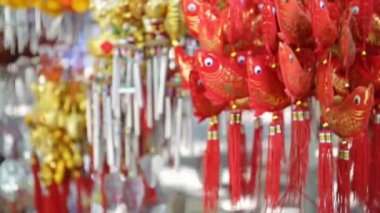 Orange Fish-shaped Mobile ornament in the market — Stock Video
