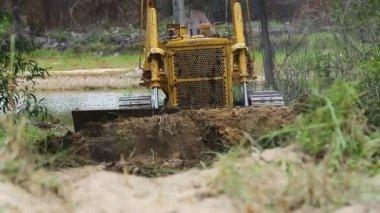 Unidentified worker control Bulldozer to excavator grader removing the ground — Stok video