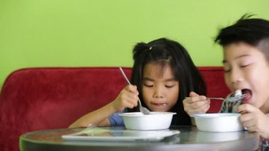 Asian child eating an ice creme in relax time . — Stock Video