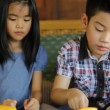 Happy asian child enjoy eating cake together — Stock Video #76320121