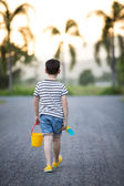 Asian cute boy playing with toys in garden — Stock Photo