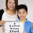 Asian mother and son with blank white board and looking camera — Stock Photo #78789830