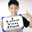 Asian boy is little smile with blank white board and looking cam — Stock fotografie #78797742